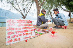 Nepal - 23 December 2017 :: prophet see fingerprint and foretell. To Nepalese man, believe royalty free stock image
