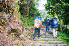 Nepal - 25 December 2016 :: Sherpas carry heavy backpack and wal Stock Photo