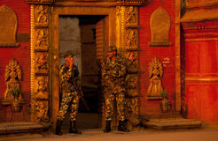 Nepal duba square. 2011 January 4,, in Nepal's capital Kathmandu duba square, two soldiers in Nepal resplendent and magnificent golden gate before on guard Royalty Free Stock Photos