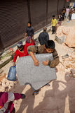 Nepal Earthquake 2015. MP007: A child carry a sleeping bag to sleep in open air after a massive 7.8 earthquake on April 25, 2015 in Kathmandu, Nepal on April 28 Royalty Free Stock Image