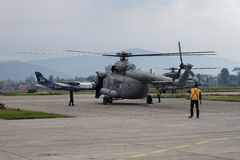 Nepal Earthquake 2015. MP044: A Indian Air Force M17 Helicopter prepares to take off with relief material to be distributed among the April 25, 2015 earthquake Royalty Free Stock Photo