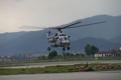 Nepal Earthquake 2015. MP052: A Indian Air Force M17 Helicopter take off with relief material to be distributed among the April 25, 2015 earthquake survivors at Stock Photos
