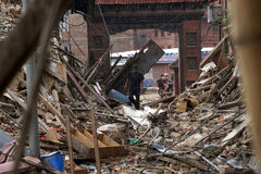 Nepal Earthquake 2015. MP028: Local residents walk on the rubble of collapsed houses completely destroyed by the earthquake at Bhaktapur Durbar Square, near Stock Photos