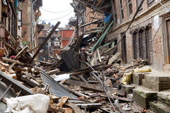 Nepal Earthquake 2015. MP028: A man walks past a collapsed house completly destroyed by the earthquake at Bhaktapur Durbar Square, near Kathmandu, Nepal on April Stock Photography
