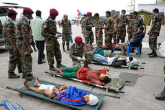 Nepal Earthquake 2015. MP053: Nepali Army medical personnel bring 25 April, 2015 earthquake victims at Tribhuvan International Airport for treatment in Kathmandu Stock Photography
