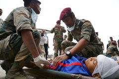 Nepal Earthquake 2015. MP055: Nepali Army medical personnel bring 25 April, 2015 earthquake victims at Tribhuvan International Airport for treatment in Kathmandu Royalty Free Stock Photo