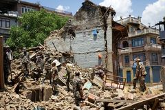 Nepal Earthquake 2015. MP080: Nepali Army personnel clear the debris at a collapsed building caused due to the earthquake on April 25, 2015, at Sankhu near Stock Photos