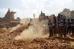 Nepal Earthquake 2015. MP078: Nepali police clear the debris in the damaged Krishna Temple caused due to the earthquake on April 25, 2015, in Patan Durbar Square Stock Image
