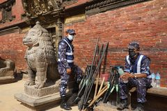 Nepal Earthquake 2015. MP079: Nepali police personnel take rest as they clear the debris in the damaged Krishna Temple caused due to the earthquake on April 25 Royalty Free Stock Photo
