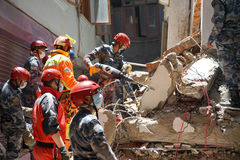 Nepal Earthquake 2015. MP074: Norwegian and Nepali rescue team look out for trapped people and dead bodies at a collapsed building during the April 25, 2015 Royalty Free Stock Images