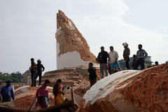 Nepal Earthquake 2015. MP002: People inspect Nepal's historic landmark Dharahara or Bhimsen Tower which collapsed following a 7.8 earthquake on April 25, 2015 in Stock Photos