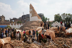 Nepal Earthquake 2015. MP008: People search for bodies at Nepal's historic landmark Dharahara or Bhimsen Tower which collapsed following a 7.8 earthquake on Royalty Free Stock Images