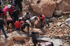 Nepal Earthquake 2015. MP024: People search for bodies at Nepal's historic landmark Dharahara or Bhimsen Tower which collapsed following a 7.8 earthquake on Royalty Free Stock Images
