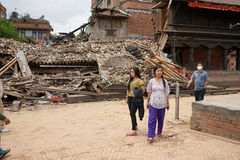 Nepal Earthquake 2015. MP013:People walk past a collapsed house completly destroyed by the earthquake at Bhaktapur Durbar Square, near Kathmandu, Nepal on April Stock Images