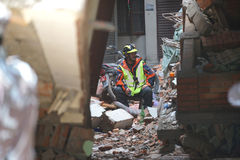 Nepal Earthquake 2015. MP062: A rescue team personnel takes rest as he looks out for trapped people and dead bodies at a collapsed building during the April 25 Royalty Free Stock Photos