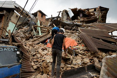 Nepal Earthquake 2015. MP016: Residents search for their belongings from the debris of a residential building completely destroyed by the earthquake at Bhaktapur Royalty Free Stock Image