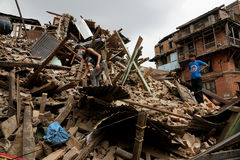 Nepal Earthquake 2015. MP018: Residents search for their belongings from the debris of a residential building completely destroyed by the earthquake at Bhaktapur Royalty Free Stock Photos