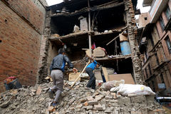 Nepal Earthquake 2015. MP019: Residents search for their belongings from the debris of a residential building completely destroyed by the earthquake at Bhaktapur Royalty Free Stock Photography