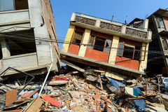 Nepal earthquakes. KATHMANDU, NEPAL - MAY 22, 2015: Two partially collapsed buildings after two major earthquakes hit Nepal on April 25 and May 12, 2015 Royalty Free Stock Photos
