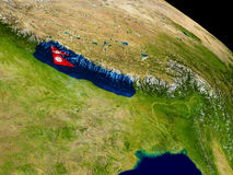 Nepal with flag on Earth Stock Image
