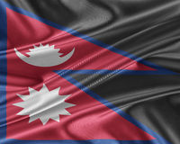 Nepal flag with a glossy silk texture. Stock Photo
