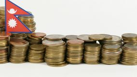 Nepal flag with stack of money coins. Nepal flag waving with stack of money coins stock footage