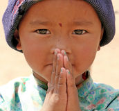 Nepal greeting of Namaste. Young girl giving the treditional Nepal greeting of Namaste Royalty Free Stock Photo