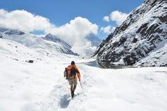 Nepal, Himalayas, october, 20, 2013. Tourist on a mountain trail in Himalayas stock photos