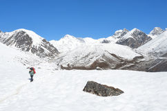 Nepal, Himalayas, October, 20, 2013. Tourist on a mountain trail in Himalayas royalty free stock photo