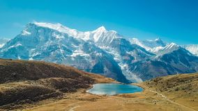 Nepal - Ice lake with the view on Annapurna Chain royalty free stock image