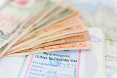 Nepal Immigration Visa for tourism and Nepali Notes royalty free stock photos