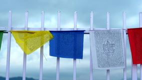 Buddhist prayer flags fluttering in the wind stock video footage
