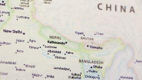 Nepal on a Map. Nepal on a political map of the world. Video defocuses showing and hiding the map stock video footage
