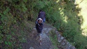 NEPAL - NOVEMBER 11, 2018: Porter Carrying Heavy Load in Himalayan-Trekking stock video