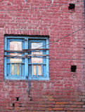 Nepal old window. Old blue window in brick wall Stock Photos