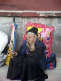 Nepal old Women. With prayer wheel Royalty Free Stock Photo