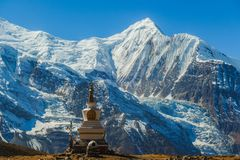 Nepal - Stupa with Annapurna Chain in the back. A stupa with Annapurna Chain as a backdrop, Annapurna Circuit Trek, Himalayas, Nepal. High mountains covered with royalty free stock image