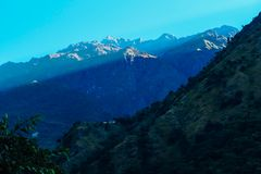 Nepal - Sun coming to the Valley throung the mountains stock images