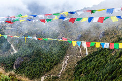 Nepal and and tibetan prayer flags in mountains Royalty Free Stock Photo