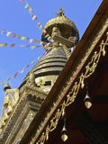 Nepal tower 3. Nepalese stupa with prayer flags in front of a blue sky Stock Images