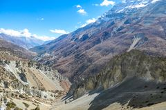 Nepal - Trek in Annapurna Circuit, Himalayas. Trek in Annapurna Circuit, Himalayas, Nepal. Trail goes on from Manang. View on the valley. Desolated and harsh stock image