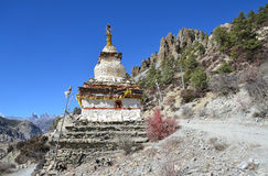 Nepal, trekking in the Himalayas. Ancient Buddhist stupa high in the mountains Stock Images