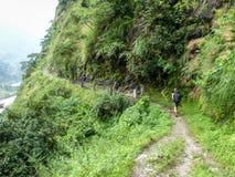 Nepal trekking. Walkway at the foot of hill - Marsyangdi river valley - Annapurna Circuit trek - Nepal stock photos