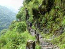 Nepal trekking. Walkway at the foot of hill - Marsyangdi river valley - Annapurna Circuit trek - Nepal royalty free stock photos