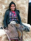 Nepal woman sitting before her lodge Royalty Free Stock Photography