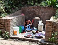 Nepal. A woman washes clothes. Royalty Free Stock Photo