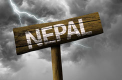 Nepal wooden sign on a bad day Royalty Free Stock Photos