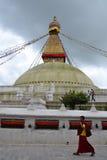 Nepal. A young Buddhist monk is walking by Bodhnath stupa Stock Image