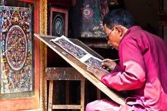 Nepalese artist  creates traditional mandala painting. BHAKTAPUR, NEPAL - APR 05: Nepalese artist  creates traditional mandala painting  on Apr 05, 2014 in Royalty Free Stock Photo