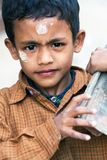 Nepalese boy with bricks Stock Images